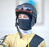 Channing Hill tries to keep warm at Aqueduct.