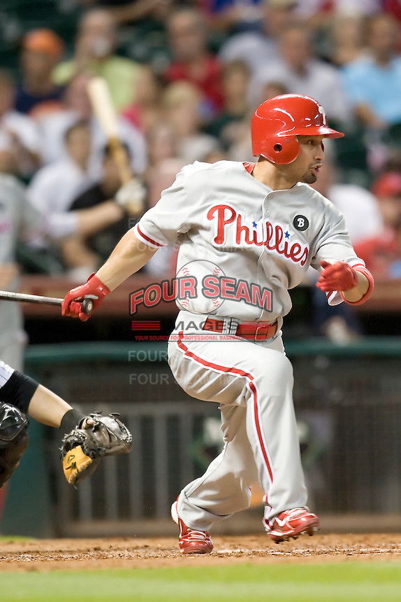 Philadelphia Phillies outfielder Shane Victorino #8 follows through during the Major League Baseball game against the Houston Astros at Minute Maid Park in Houston, Texas on September 12, 2011. Houston defeated Philadelphia 5-1.  (Andrew Woolley/Four Seam Images)