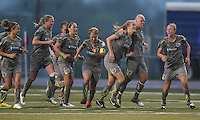 Allison Falk (3) is congratulated by teammates after scoring her second goal of the season, which proved to be the game-winner.  Philadelphia defeated Washington 3-1, in their first win of the season at John A. Farrell Stadium in West Chester, PA.