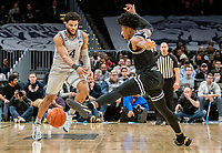 WASHINGTON, DC - FEBRUARY 19: Jagan Mosely #4 of Georgetown aims a pass around David Duke #3 of Providence during a game between Providence and Georgetown at Capital One Arena on February 19, 2020 in Washington, DC.