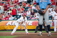 Stephen Piscotty (12) of the Springfield Cardinals takes a lead off of first base during a game against the Northwest Arkansas Naturals at Hammons Field on August 23, 2013 in Springfield, Missouri. (David Welker/Four Seam Images)