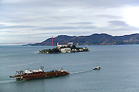 aerial photograph tug pulling loaded barge Alcatraz island San Francisco
