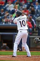 Akron RubberDucks shortstop Erik Gonzalez (10) at bat during a game against the New Britain Rock Cats on May 21, 2015 at Canal Park in Akron, Ohio.  Akron defeated New Britain 4-2.  (Mike Janes/Four Seam Images)