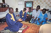 - immigrants from Senegal celebrate Islamic prayer in their home in province of Bergamo....- Immigrati dal Senegal celebrano la preghiera islamica nella loro abitazione in provincia di Bergamo