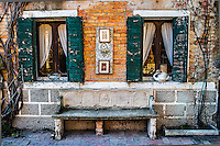 Bench in front of house on Torcello Island, Italy
