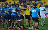 The teams discuss fashion trends during the Super Rugby Aotearoa match between the Hurricanes and Blues at Sky Stadium in Wellington, New Zealand on Saturday, 18 July 2020. Photo: Dave Lintott / lintottphoto.co.nz