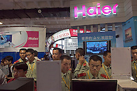A group a PLA men use Haier computers in International High-tech expo in Beijing, China..