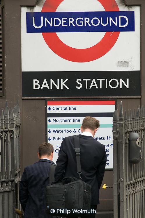 City workers enter Bank underground station.