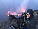 Democratic Republic of Congo, Photographer Art Wolfe at edge of Nyiragongo Volcano
