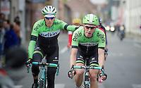 Sep Vanmarcke (BEL/Belkin) is escorted back into the peloton by teammate Jos van Emden (NLD/Belkin) while being provided with fresh bidons from the teamcar along the way<br /> <br /> Ronde van Vlaanderen 2014