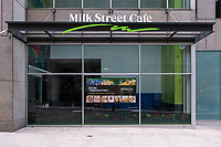 "A sign on the doors and windows of Milk Street Cafe, indicates that the establishment is temporarily closed in hibernation due to restrictions on restaurants put in place during the ongoing Coronavirus (COVID-19) global pandemic in Boston, Massachusetts, on Sat., Jan. 9, 2021. The restaurant closed on Oct. 27, 2020, and an announcement at the time stated that it would reopen once ""more of our customers are able to return to their offices."""