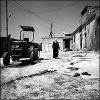 Syria/Zardana village/Sept 6,2012/ A woman passes through the place where before a few minutes three people died after a rocket attack in Zardana village, in Idlib province. Over 60,000 of Syrians have died since the uprising began in March 2011 and  more than 500,000 of Syrian refugees have fled the country to neighboring Turkey,Lebanon,Jordan and Iraq.Giorgos Moutafis