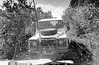 Albania. Province of Kruma. Lata. On the border between Albania and Kosovo. Swiss Foundation for Mine Action ( Fédération suisse de déminage - FSD). Mine -clearing and clearance operations of landmines and unexplosed ordnance (UXO). Two  FSD Landrover jeep vehicles drive  on tiny dirt roads in the safety zone. 20.09.03 © 2003 Didier Ruef