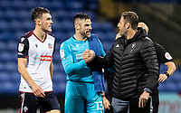 Bolton Wanderers' goalkeeper/coach Matthew Gilks (centre) is congratulated on victory and keeping a clean sheet by Salford City's goalkeeping coach Carlo Nash (right) <br />