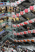 A shopping mall is crowded on a Saturday in Chengdu, China. Economic conditions had been greatly improved both domestically and externally as China's economy consolidates its recovering trend. According to the figures from the National Bureau of Statistics (NBS), China's consumer price index (CPI), a main gauge of inflation, rose 0.6 percent year on year in November..05 Dec 2009.