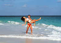 Young couple playing at the beach