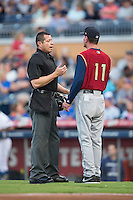 Home plate umpire Carlos Torres explains a call to Scranton/Wilkes-Barre RailRiders manager Dave Miley (11) during the game against the Durham Bulls at Durham Bulls Athletic Park on May 15, 2015 in Durham, North Carolina.  The RailRiders defeated the Bulls 8-4 in 11 innings.  (Brian Westerholt/Four Seam Images)