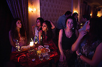 Locals relax during a Saturday night meeting of several Latin dance groups, at the Omayad Hotel, in Damascus, Syria.