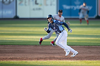 West Michigan Whitecaps third baseman Spencer Torkelson (8) runs to third base against the Great Lakes Loons at LMCU Ballpark on May 11, 2021 in Comstock Park, Michigan. The Loons defeated the Whitecaps in their home opener 9-1. (Andrew Woolley/Four Seam Images)