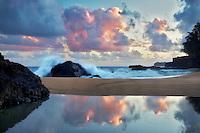 Sunrise and tide pool reflection. Kauai, Hawaii
