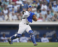 Paul Lo Duca of the Los Angeles Dodgers makes a throw during a 2002 MLB season game at Dodger Stadium, in Los Angeles, California. (Larry Goren/Four Seam Images)