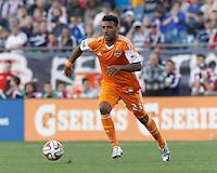 Houston Dynamo forward Giles Barnes (23) brings the ball forward.  In a Major League Soccer (MLS) match, the New England Revolution (blue/white) defeated Houston Dynamo (orange), 2-0, at Gillette Stadium on April 12, 2014.