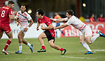Nathan Hirayama of Canada runs with the ball while Charlie Hayter of England (right) tries to stop him during the match Canada vs England, Day 2 of the HSBC Singapore Rugby Sevens as part of the World Rugby HSBC World Rugby Sevens Series 2016-17 at the National Stadium on 16 April 2017 in Singapore. Photo by Victor Fraile / Power Sport Images