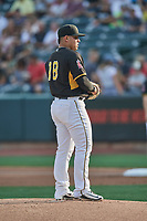 Salt Lake Bees starting pitcher Jose Suarez (18) looks for the sign against the Nashville Sounds at Smith's Ballpark on July 28, 2018 in Salt Lake City, Utah. The Bees defeated the Sounds 11-6. (Stephen Smith/Four Seam Images)