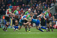Nick Evans of Harlequins is tackled during the Heineken Cup match between Harlequins and Connacht Rugby at The Twickenham Stoop on Saturday 12th January 2013 (Photo by Rob Munro).