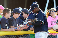 Empire State Yankees shortstop Yadil Mujica #1 signs autographs before a game against the Pawtucket Red Sox at Dwyer Stadium on May 5, 2012 in Batavia, New York.  Pawtucket defeated Empire State 9-3.  (Mike Janes/Four Seam Images)