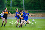 David Spillane Spa stops Jack O'Shea Austin Stacks getting the loose ball as Dan O'Donoghue watches on during their County league game in Spa on Saturday night