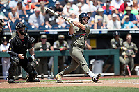 Vanderbilt Commodores designated hitter Ty Duvall (20) follows through on his swing during Game 3 of the NCAA College World Series against the Louisville Cardinals on June 16, 2019 at TD Ameritrade Park in Omaha, Nebraska. Vanderbilt defeated Louisville 3-1. (Andrew Woolley/Four Seam Images)