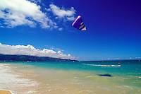 A Maui kitesurfer on the North Shore at Kanaha Beach
