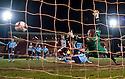 Pars' Jordan Moore (12) scores their late equalising goal.