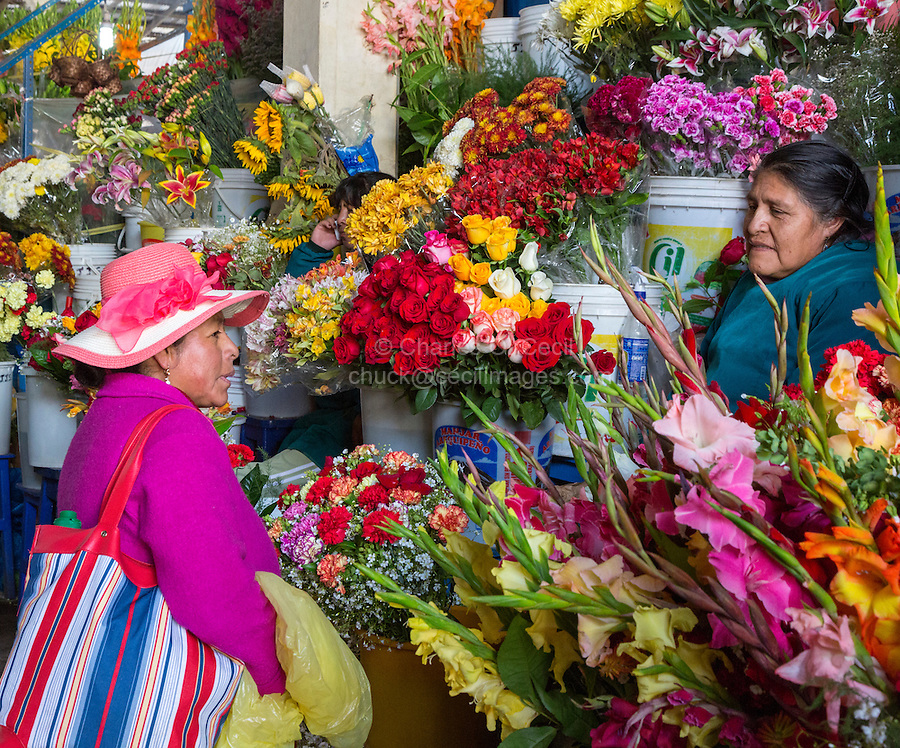 Peru, Cusco.  San Pedro Market.  Flower Vendor and Customer.