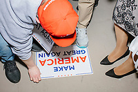 "A campaign sign reading ""Make America Great Again"" lays on the floor after Donald Trump, Jr., the son of US president Donald Trump, spoke at a 'Make America Great Again!' campaign rally at DoubleTree by Hilton MHT in Manchester, New Hampshire, on Thu., Oct. 29, 2020. The event took place five days before the Nov. 3 presidential election."