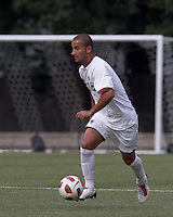 Boston College forward/midfielder Amit Aburmad (7) brings the ball forward. Boston College defeated Quinnipiac, 5-0, at Newton Soccer Field, September 1, 2011.