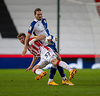 19th December 2020; Bet365 Stadium, Stoke, Staffordshire, England; English Football League Championship Football, Stoke City versus Blackburn Rovers; Nathan Collins of Stoke City is manhandled down by Sam Gallagher of Blackburn Rovers