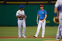 Philadelphia Phillies Matt Joyce (35), on rehab assignment with the Clearwater Threshers, talks with shortstop Orelvis Martinez (11) during a game against the Dunedin Blue Jays on May 18, 2021 at BayCare Ballpark in Clearwater, Florida.  (Mike Janes/Four Seam Images)