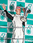 05 Apr 2009, Kuala Lumpur, Malaysia ---   Brawn GP Formula One Team driver Jenson Button of Great Britain holds the trophy on the podium after winning the 2009 Fia Formula One Malasyan Grand Prix at the Sepang circuit near Kuala Lumpur. Photo by Victor Fraile --- Image by © Victor Fraile / The Power of Sport Images