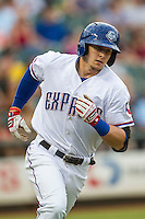 Round Rock Express outfielder Ryan Rua (12) runs to first base during the Pacific Coast League baseball game against the Oklahoma City RedHawks on August 1, 2014 at the Dell Diamond in Round Rock, Texas. The Express defeated the RedHawks 6-5. (Andrew Woolley/Four Seam Images)