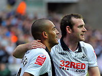 ATTENTION SPORTS PICTURE DESK<br /> Pictured: Darren Pratley of Swansea (L) with Craig Beattie (R) celebrating the former's goal, bringing his team forward in score 3-2 during the second half.<br /> Re: Coca Cola Championship, Swansea City Football Club v Cardiff City FC at the Liberty Stadium, Swansea, south Wales. Saturday 07 November 2009
