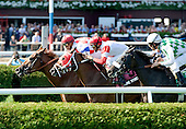 Beau Choix (far left) rallies on the inner turf course.