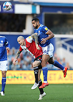 31st October 2020; The Kiyan Prince Foundation Stadium, London, England; English Football League Championship Football, Queen Park Rangers versus Cardiff City; Will Vaulks of Cardiff City and Lyndon Dykes of QPR contesting a high ball