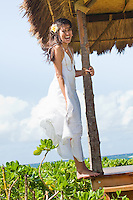 Young Hawaiian woman enjoying a sunny day in a beachfront gazebo