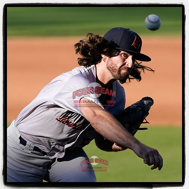 Miller Hogan (5) of the Bowling Green Hot Rods delivers a pitch late in a game against the Greenville Drive on Thursday, May 6, 2021, at Fluor Field at the West End in Greenville, South Carolina. (Tom Priddy/Four Seam Images)