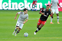 WASHINGTON, DC - NOVEMBER 8: Bojan #9 of Montreal Impact battles for the ball with Ola Kamara #9 of D.C. United during a game between Montreal Impact and D.C. United at Audi Field on November 8, 2020 in Washington, DC.