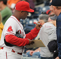 First-year manager Billy McMillon (51) of the Greenville Drive, Class A affiliate of the Boston Red Sox, signs the shirt of a fan prior to a game against the Delmarva Shorebirds on Opening Day, April 8, 2010, at Fluor Field at the West End in Greenville, S.C. Photo by: Tom Priddy/Four Seam Images