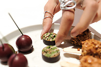 """Modena, 24 February 2017 – The """"Camouflage: a hare in the woods"""" petit fours being picked up at Osteria Francescana, Modena, Italy. Photo Sydney Low"""