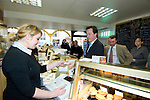 David Cameron, the Conservative Party leader pays for his lunch at the Myrddin Bakery in Carmarthen today as he toured the area and spoke to local businesses during his visit to South Wales today..The Conservatives want to introduce a bill demanding compulsory country of origin labelling, which will require products carrying the UK flag to be born, reared and processed in Britain...